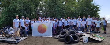 CooperVision team members pose with collected debris following the International Coastal Cleanup in Juana Diaz, Puerto Rico.