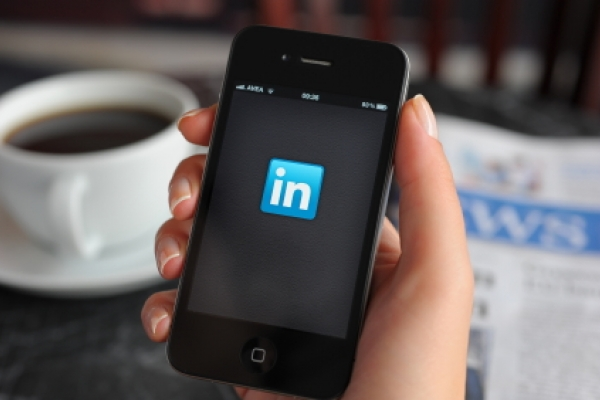iPhone with LinkedIn logo