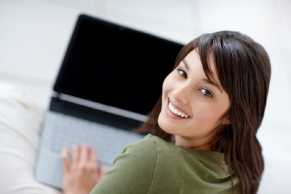 Smiling girl on laptop