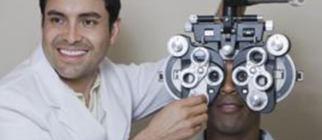 eye care practitioner smiling during eye exam