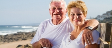 mature couple smiling at the beach