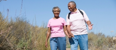 mature couple smiling on a walk