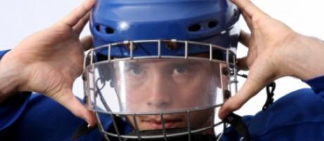 young boy wearing helmet