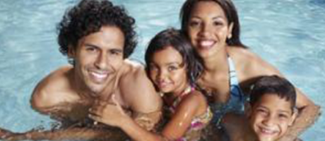 family smiling and swimming