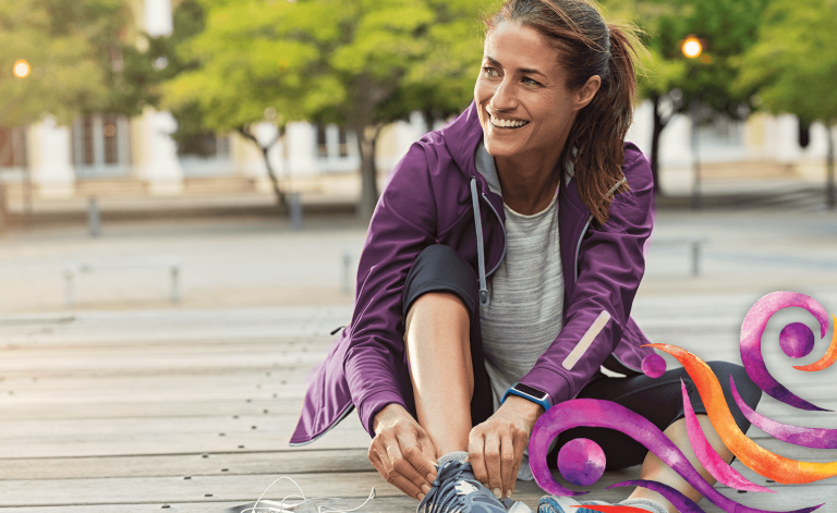 active woman smiling and tying shoes
