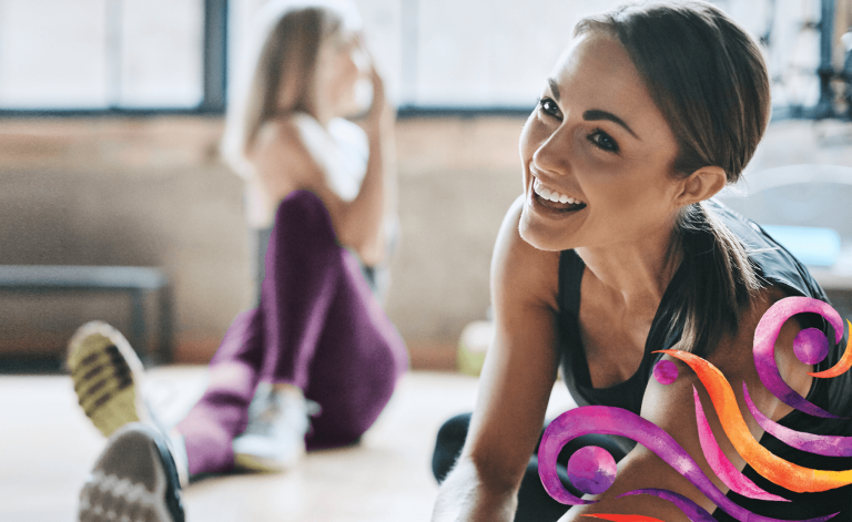 active woman smiling and stretching