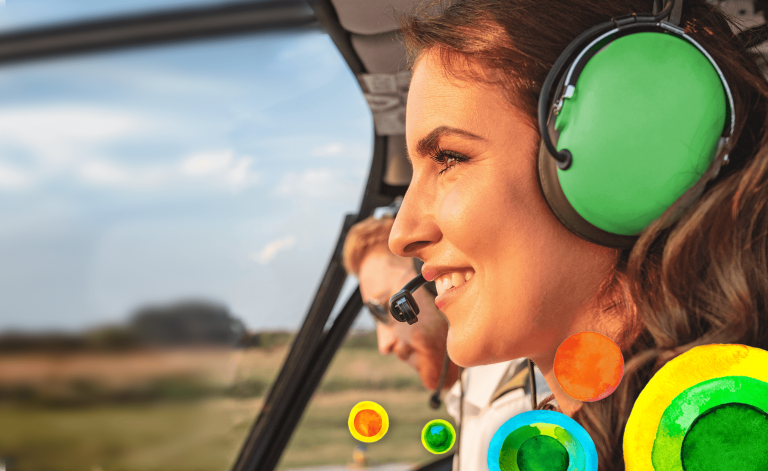 man and woman smiling in a helicopter