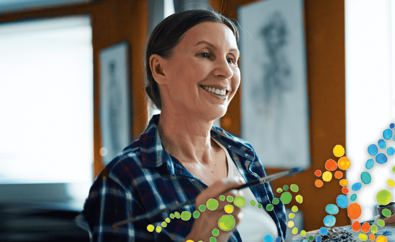 woman smiling and painting