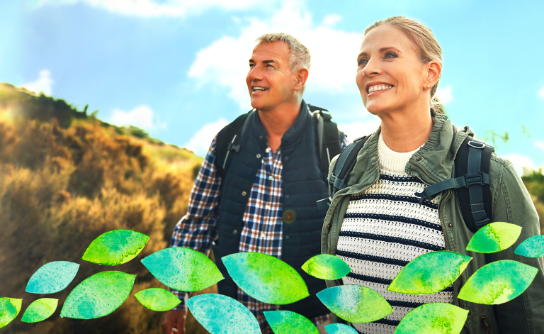 mature man and woman smiling on a hike